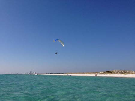 Paragliders on the beach